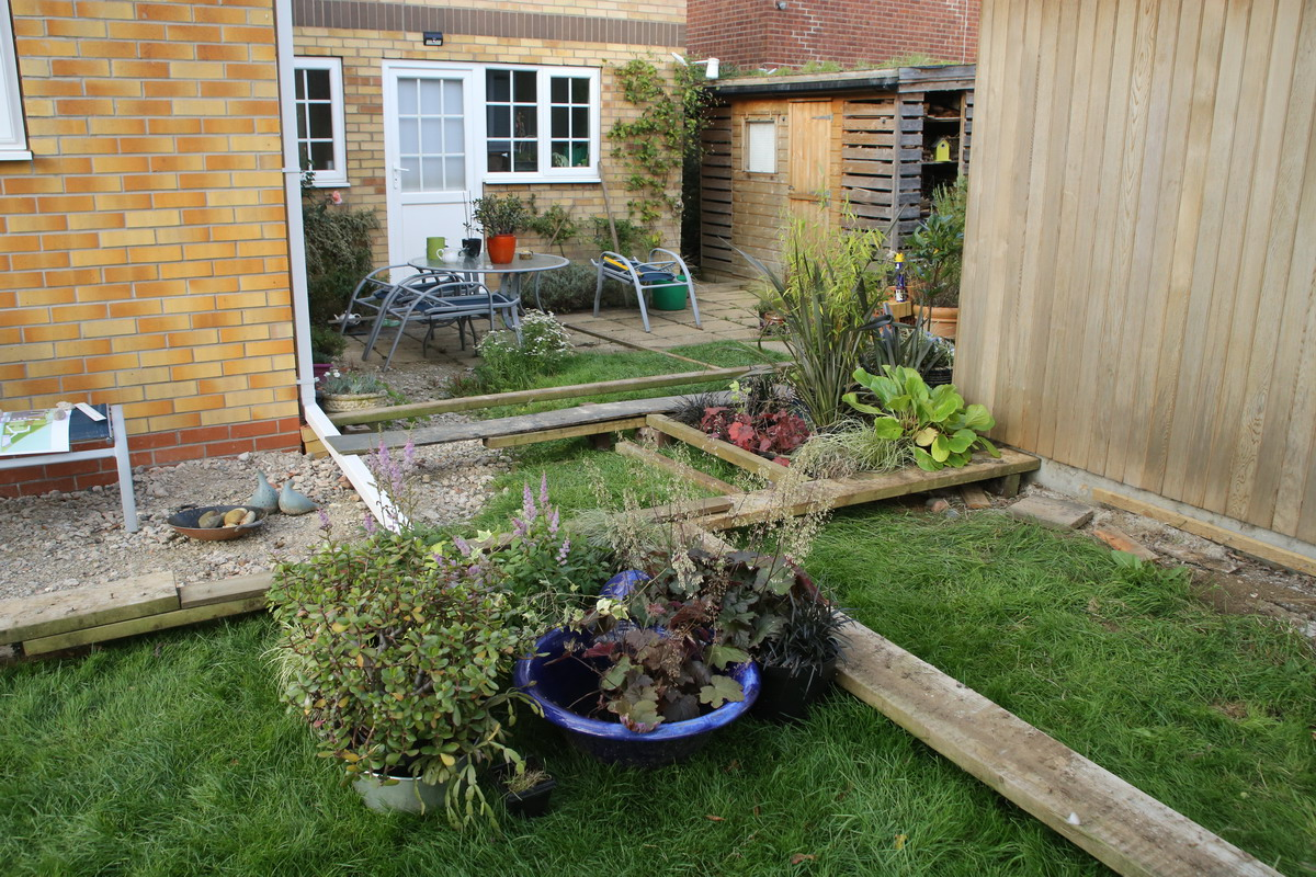 Planks and plants help us to visualise the size and level of the patio and deck